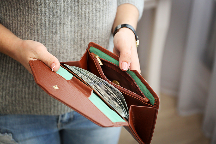 Girl with brown wallet full of money